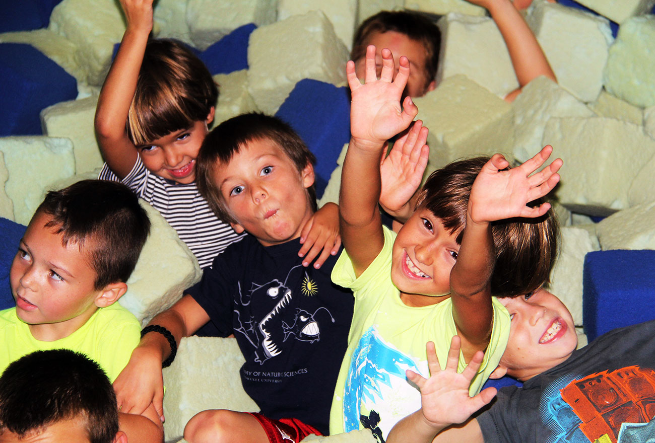 A group of boys enjoys the faom pit at a birthday party