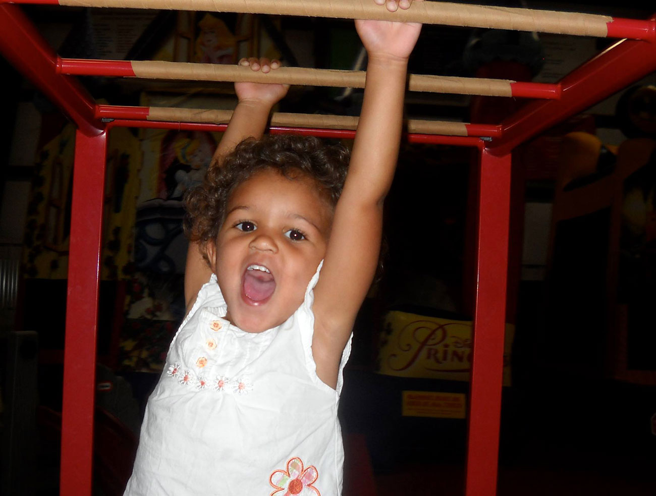 A student has fun on the monkey bars